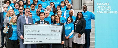 Los Angeles City Librarian John Szabo (front row, from left), Councilmember David Ryu, and ALA President Loida Garcia-Febo hold a giant check for nearly $4.8 million, symbolizing the efforts of the nearly 7,500 volunteers who contributed 164,000 hours of work in Los Angeles Public Library's 73 locations in 2018. Photo by Los Angeles Public Library