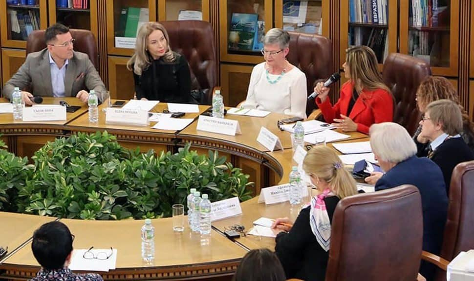 American Library Association President Loida Garcia-Febo (in red) speaks to librarians at the Russian State Library in Moscow.
