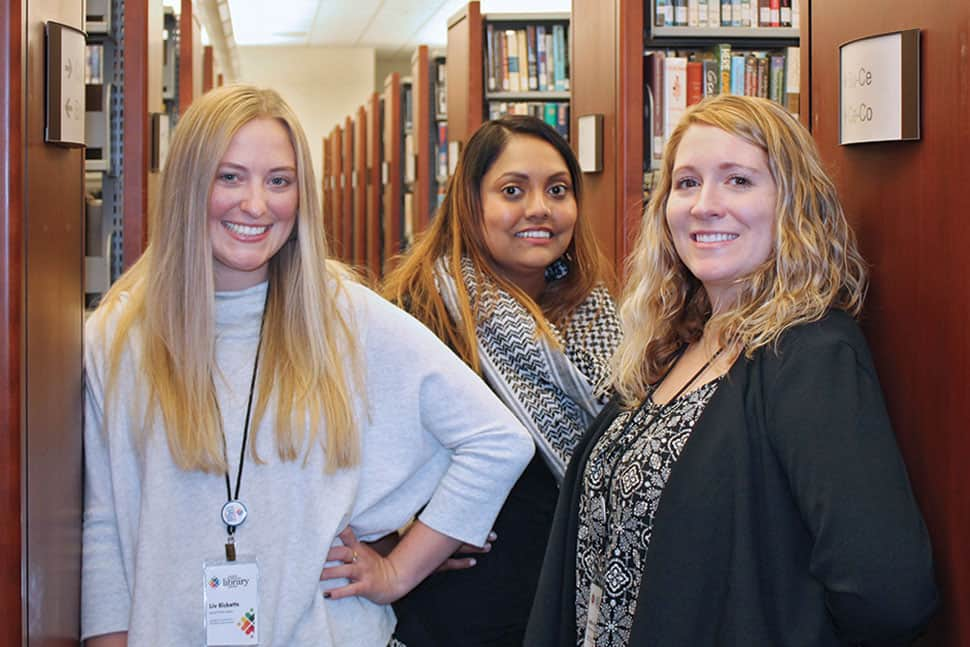 Students Olivia Ricketts (left), Simone Moonsammy (center), and Lydia Hall from the University of Georgia School of Social Work provide trauma-informed services and training at Athens-Clarke County (Ga.) Library. (Photo: Caleb Guice)