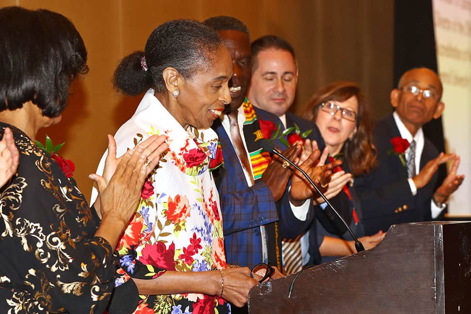 Pauletta Bracy (second from left) gets a standing ovation as she receives the Virginia Hamilton Award for Lifetime Achievement during the Coretta Scott King Book Awards 50th Anniversary Breakfast.
