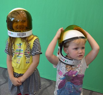 Kids pose as astronauts in front of a green screen at Westminster (Co.) Public Library. Photo: Stephanie Vierow-Fields