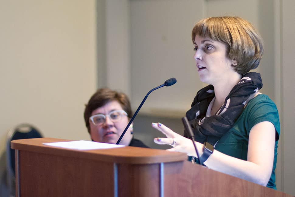 Amy Tureen (left, seated) and Amanda Melilli (right, standing at podium).