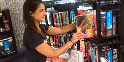 Kristina Graves, a Schenectady (N.Y.) City School District librarian, places a book at the bookmobile table