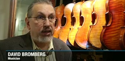 David Bromberg and his violin collection. Screenshot from newscast
