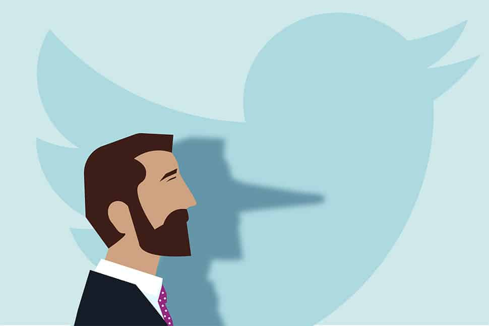 Man whose shadow nose extends Pinocchio-style in front of the Twitter bird logo