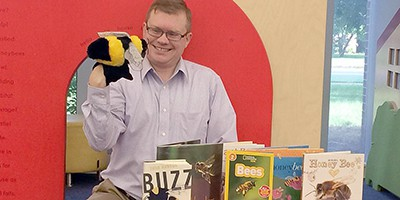Chesapeake (Va.) Central Library Branch manager Zachary Elder with educational bee materials