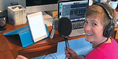 Amy Hermon recording an episode of School Librarians United
