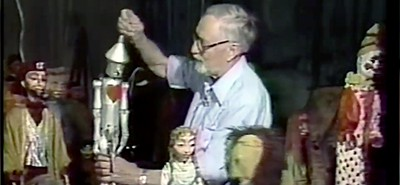 Meredith Bixby and his marionettes. Screenshot from UM video