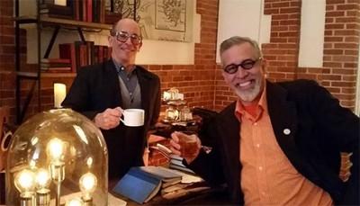 Adam Zand (left) and Greg Peverill-Conti take a break in the Map Room Tea Lounge at Boston Public Library in Copley Square (Photo: Library Land Project Instagram).