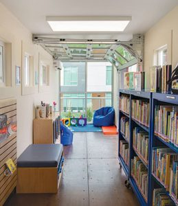 "Windows and a garage door make the 320-square-foot building feel more spacious. <span class=""credit"">Photo: Macey Snelson/Meridian (Idaho) Library District</span>"