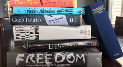 Stack of books related to media literacy, ethics, sociology, and history (Photo by Tim Wise)