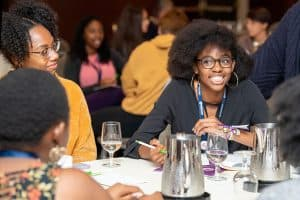 Sade Wilkins El (right), an intern with Public Library Association's Inclusive Internship Initiative (III), networks at the III wrap-up event in Washington, D.C.