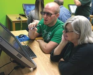 Teachers at Waubonsie Valley High School try out zSpace's AR/VR laptops.