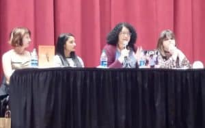 From left, YA authors Lauren Myracle, Sandhya Menon, Kekla Magoon, and Meredith Russo speak at the Opening Session of the Young Adult Library Services Association's Young Adult Services Symposium on November 1 in Memphis, Tennessee.