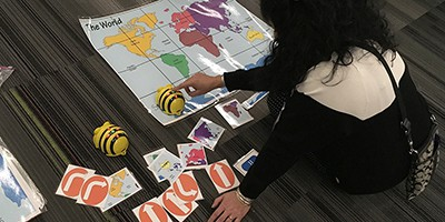 "A librarian uses a Bee Bot at ""Do the Bot—Librarians Using Robots to Impact Learning"" at AASL 2019. Photo by Phil Morehart"