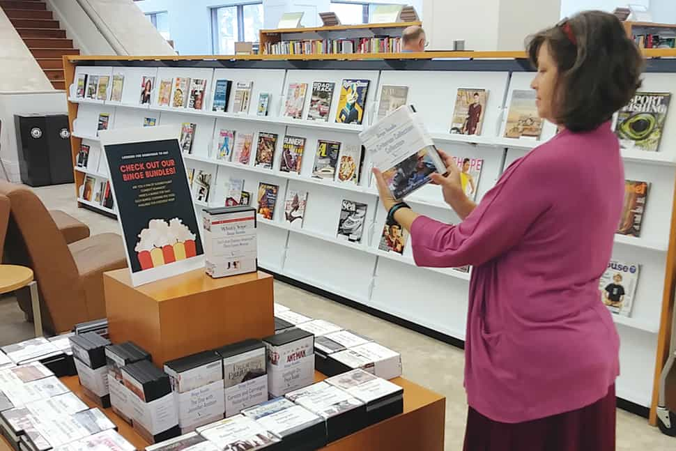 Leah Elzner, a staff member at Mandel Public Library in West Palm Beach, Florida, looks over the latest binge bundles. (Photo: Mandel Public Library in West Palm Beach, Florida)