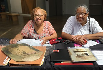 Visitors to the California African American Museum used Los Angeles Public Library's Mobile Memory Lab to digitize family photos and documents at an August 2019 event at the museum. Photo: Los Angeles Public Library.