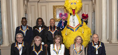 The recipients of the 42nd Annual Kennedy Center Honors pose for a group photo following a dinner at the US Department of State in Washington, D.C., on December 7. Photo by UPI / Barcroft Media