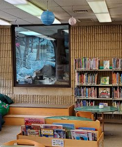 """The children's section at Punxsutawney Memorial Library features a window to Phil's habitat. <span class=""""credit"""">Photo: Punxsutawney Memorial Library</span>"""