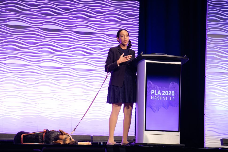 Disability rights advocate Haben Girma (and her guide dog Milo) on stage at the Public Library Association 2020 Conference in Nashville February 28. (Photo: Laura Kinser/Kinser Studios)