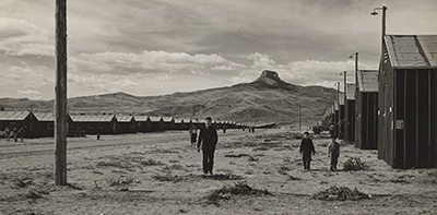 Internees roam the desolate Heart Mountain Relocation Center near Cody, Wyoming, in 1942. Photo by Tom Parker