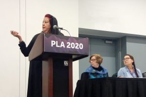 From left: Melanie Toledo (at podium), Carolyn Petersen, and Janessa Esquivel.