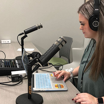 A student at Norman (Okla.) North High School uses Anchor to record a podcast.