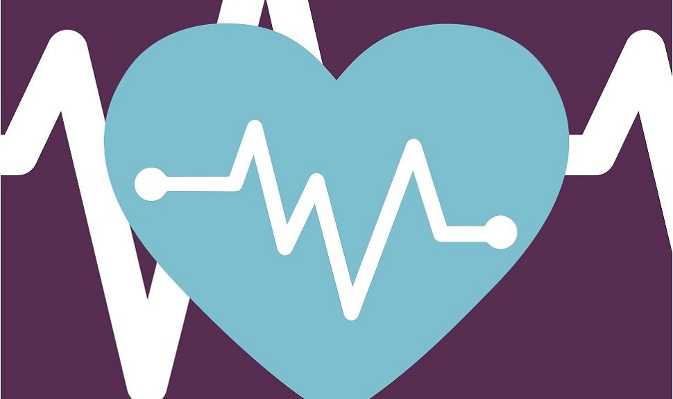 Blue heart on purple background with heartbeat graph.