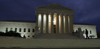 The US Supreme Court building stands at dawn in Washington, D.C. Photo by Stefani Reynolds / Bloomberg