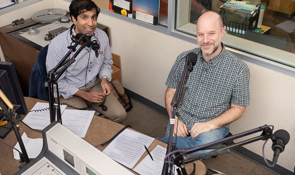Ameet Doshi (left), director of innovation and program design and subject librarian at Georgia Tech's (GT) School of Public Policy and Law, and Charlie Bennett, public engagement librarian and subject librarian for GT's School of Economics, in GT's campus radio station. (Photo: Allison Carter/Georgia Institute of Technology)