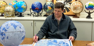 Kevin Dzurny, chief cartographer at Replogle Globes