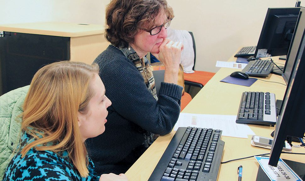Law Librarians of New England members Ashley Selima (left) and Stephanie Edwards work with Rhode Island's early suffrage documents at a 2018 transcription party. Photo: Joe Graziano/Rhode Island Department of State