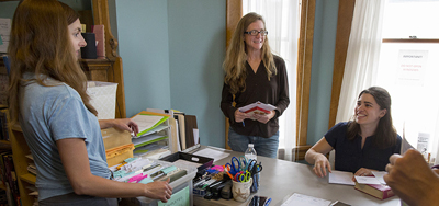 From left: Beth Staley, Katy Ryan, and Gabriella Pishotti of the Appalachian Prison Book Project in Morgantown, West Virginia. Photo by Raymond Thompson