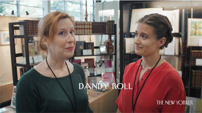 "Two booksellers discuss the term ""dandy roll"" in a screenshot from D. W. Young's short film ""A Body of Language."""
