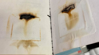 Image of burned RFID tag inside a microwaved book from Kent District Library in Comstock Park, Michigan.