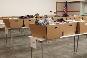 Boxes of returns organized by day in the large meeting room at Elmhurst (Ill.) Public Library. All items sit in quarantine for three days before small teams working in shifts check them in and reshelve them. Photo: Alea Perez/Elmhurst Public Library