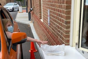 A customer picks up her reserves at the drive-through window at Columbus (Ohio) Metropolitan Library's New Albany branch.
