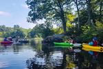 Kayaks and book lovers on the lake