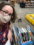 Abby Johnson, collection development librarian, pulls books for patrons