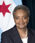 Mayor Lori Lightfoot in front of Chicago flag