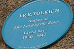 Blue historic plaque reading J.R.R. Tolkien, Author of The Lord of the Rings, Lived Here 1930-1947