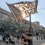 Protester holding Black Lives Matter flag