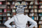 Librarian with stack of books for a head (Image: Gerd Altmann/Pixabay )