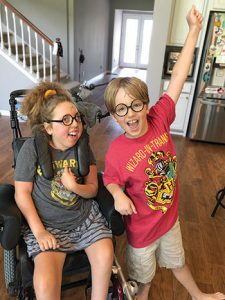 """Elena Ozment and her brother Joey celebrate completing the Harry Potter series. <span class=""""credit"""">Photo: Erin Ozment</span>"""
