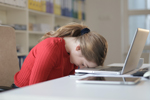 Tired woman rests her head on her laptop (Photo: Andrea Piacquadio/ Pexels)