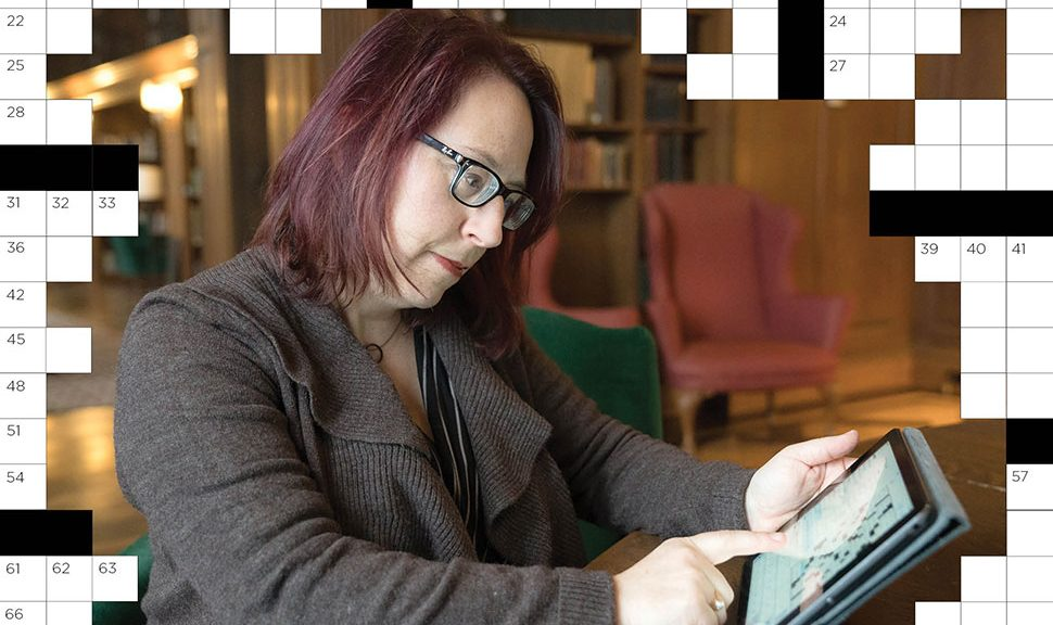 Laura Braunstein, digital humanities librarian at Dartmouth College in Hanover, New Hampshire, completes a crossword on her tablet. (Photo: Eli Burakian/Dartmouth College)