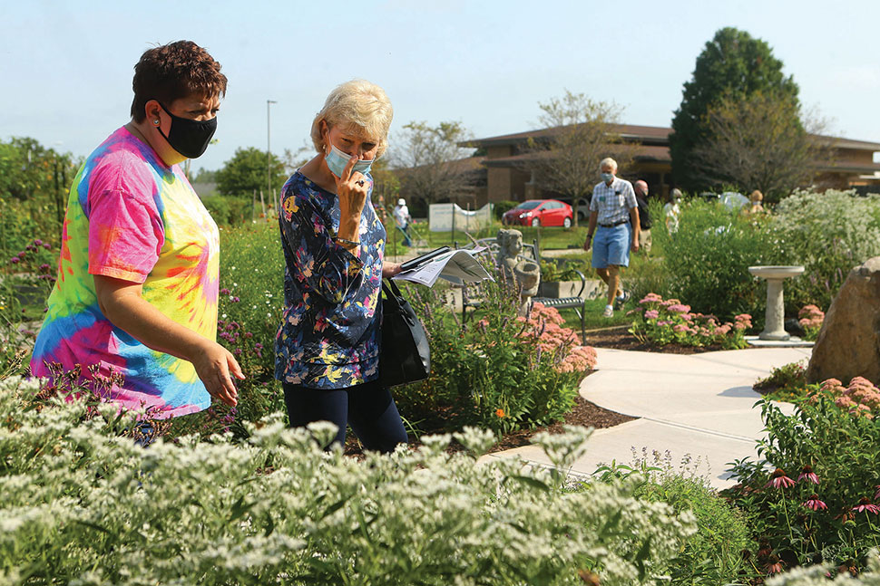 Human visitors explore the butterfly garden at Kokomo–Howard County (Ind.) Public Library's South branch. (Photo: Kokomo–Howard County (Ind.) Public Library)