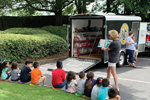 Valerie Wagley, counselor at Fair Oaks Elementary School in Cobb County, Georgia, reads to kids at a bookmobile stop in summer 2020. (Photo: Kelli Wood)
