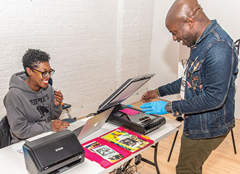 Blackivists members Stacie Williams (left) and Steven Booth scanning Chicago house music ephemera at the first Chicago Black Social Culture Map Community Archiving Day. Photo: M Thrē Photography
