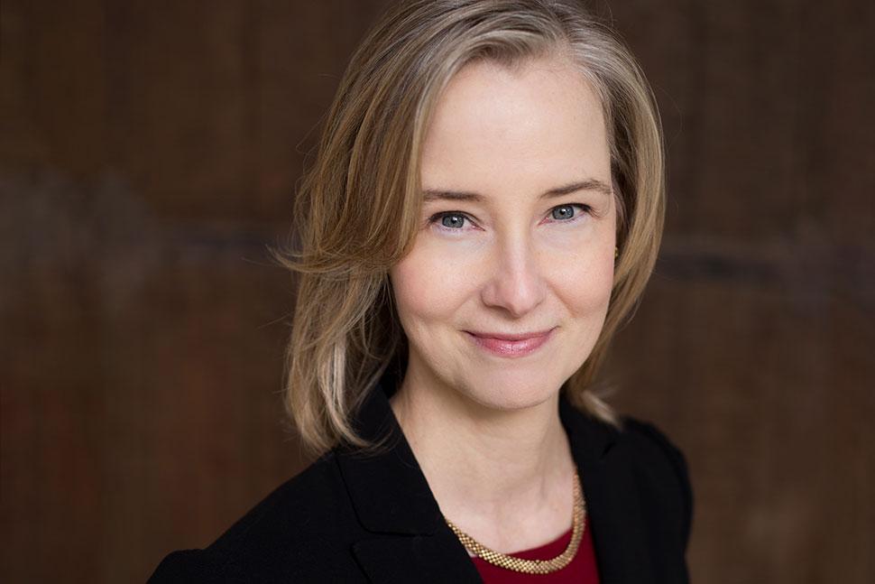 Mary Davis Fournier (white woman with blond hair against dark background)
